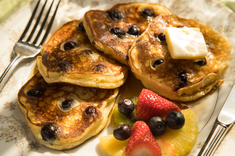 Plate with lemon ricotta pancakes and fresh fruit